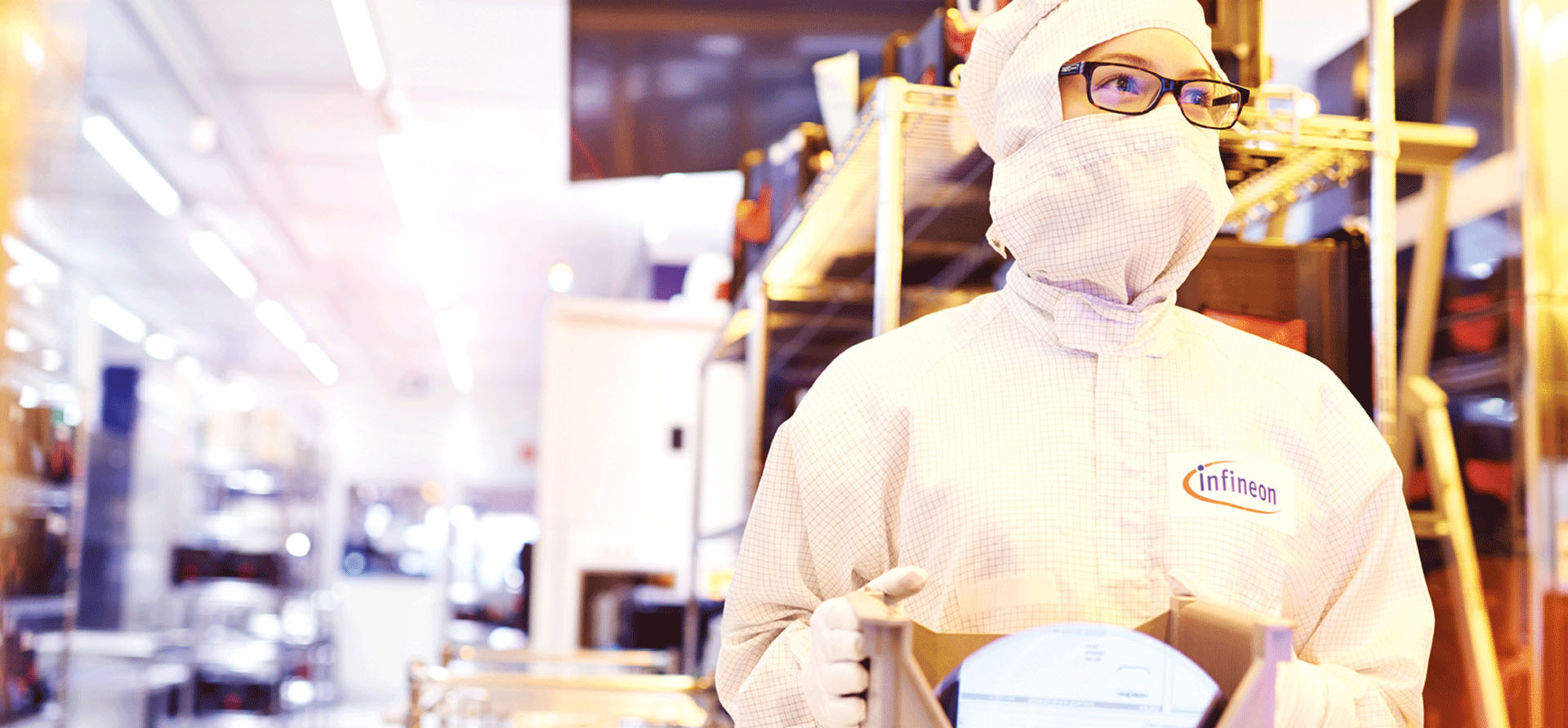 Person with protective mask working in high tech factory